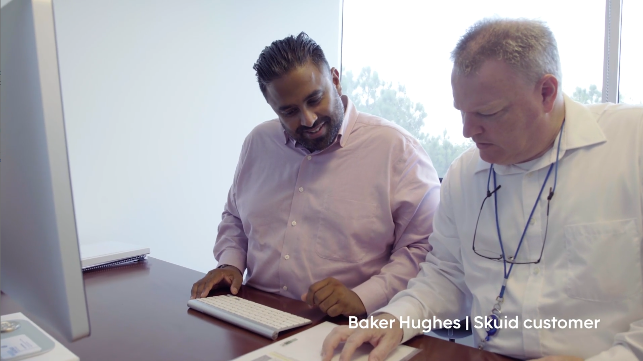 What is human-centered design? [image of two men at desk looking down at a sheet of paper] Baker Hughes | Skuid customer