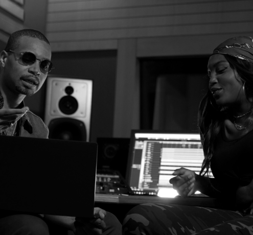 Two producers singing together.