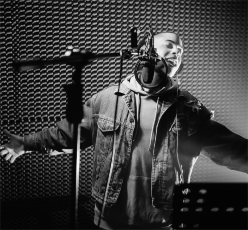 A producer singing in a accoustic room.