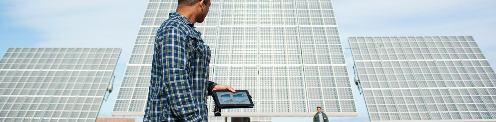 man monitoring generation at a solar plant