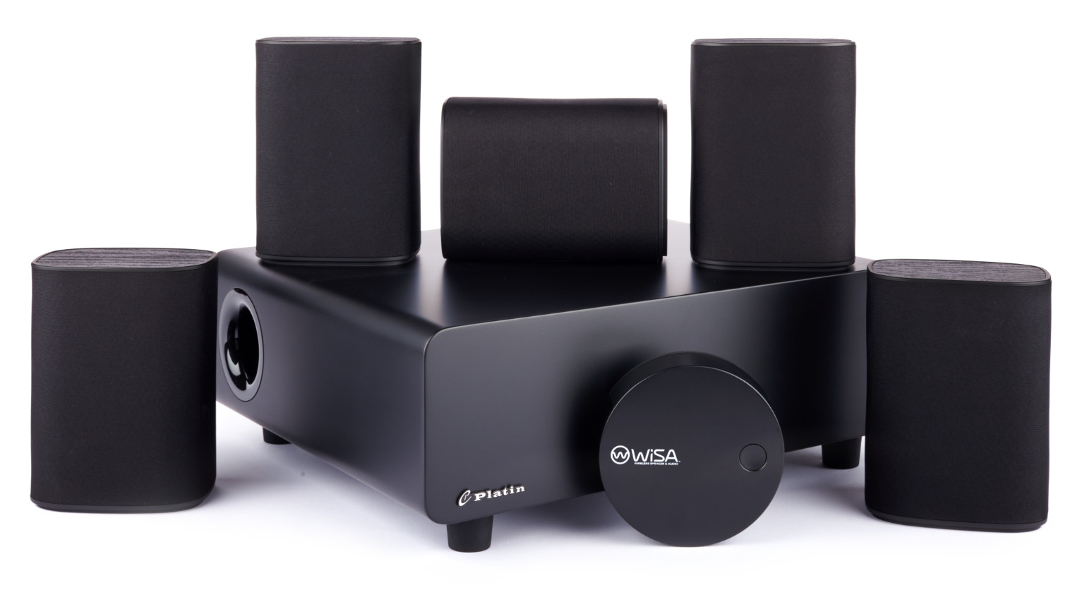 The Platin Milan 5.1 wireless audio system features one subwoofer, one center satellite speaker, two front satellite speakers, and two rear satellite speakers, and one WiSA SoundSend wireless audio transmitter. Components are very compact, black, and stylish.