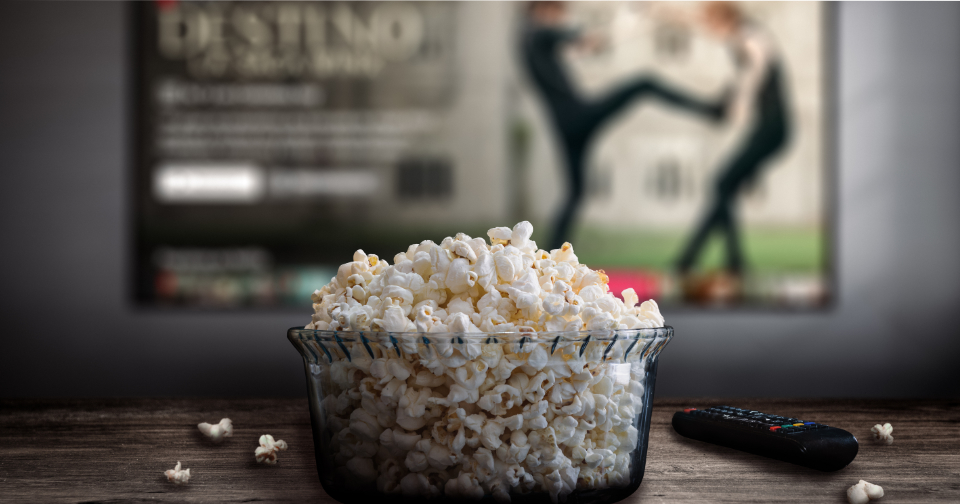 Close up image of popcorn in a glass bowl