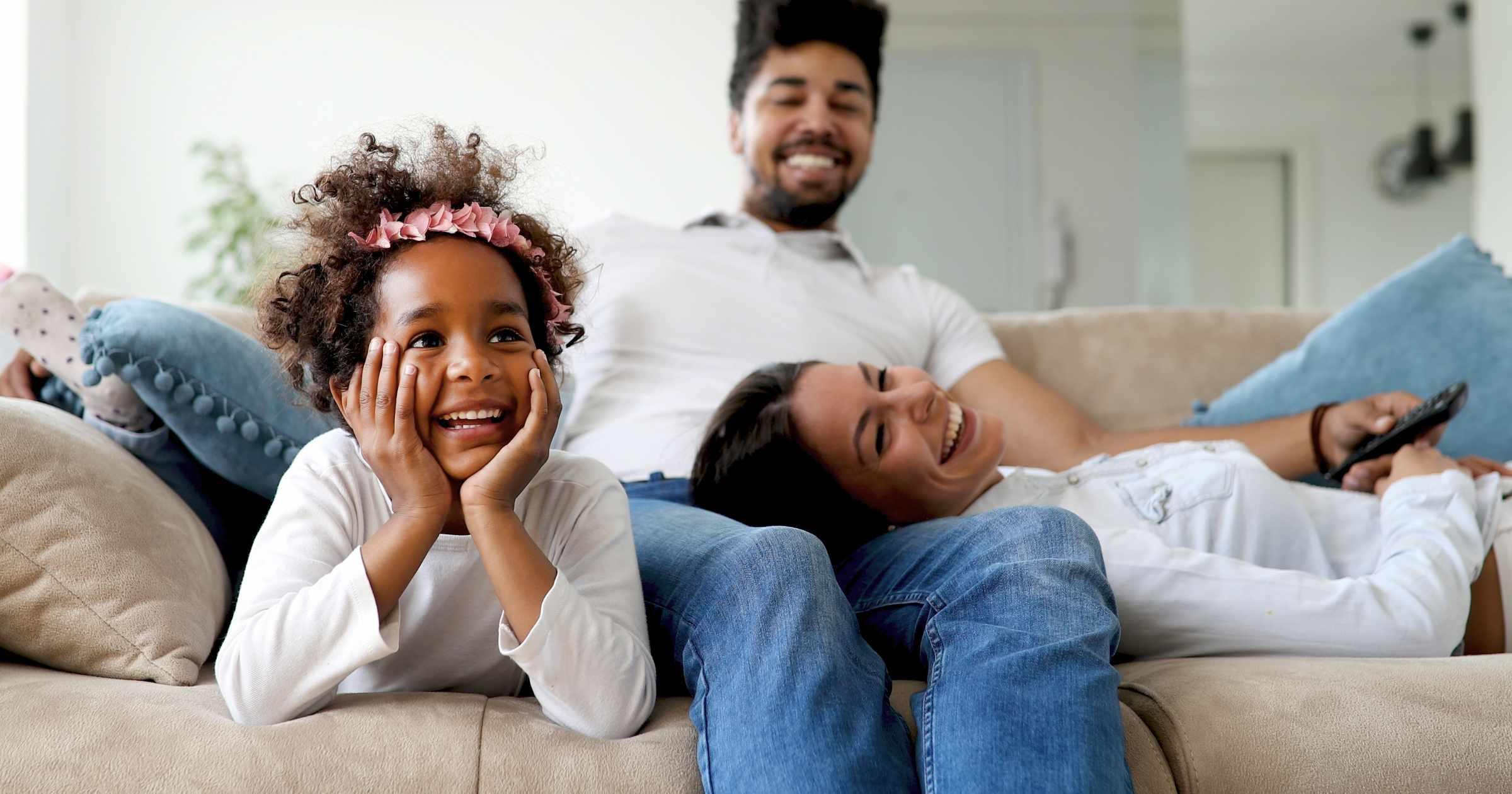 Family enjoying cinema sound together.