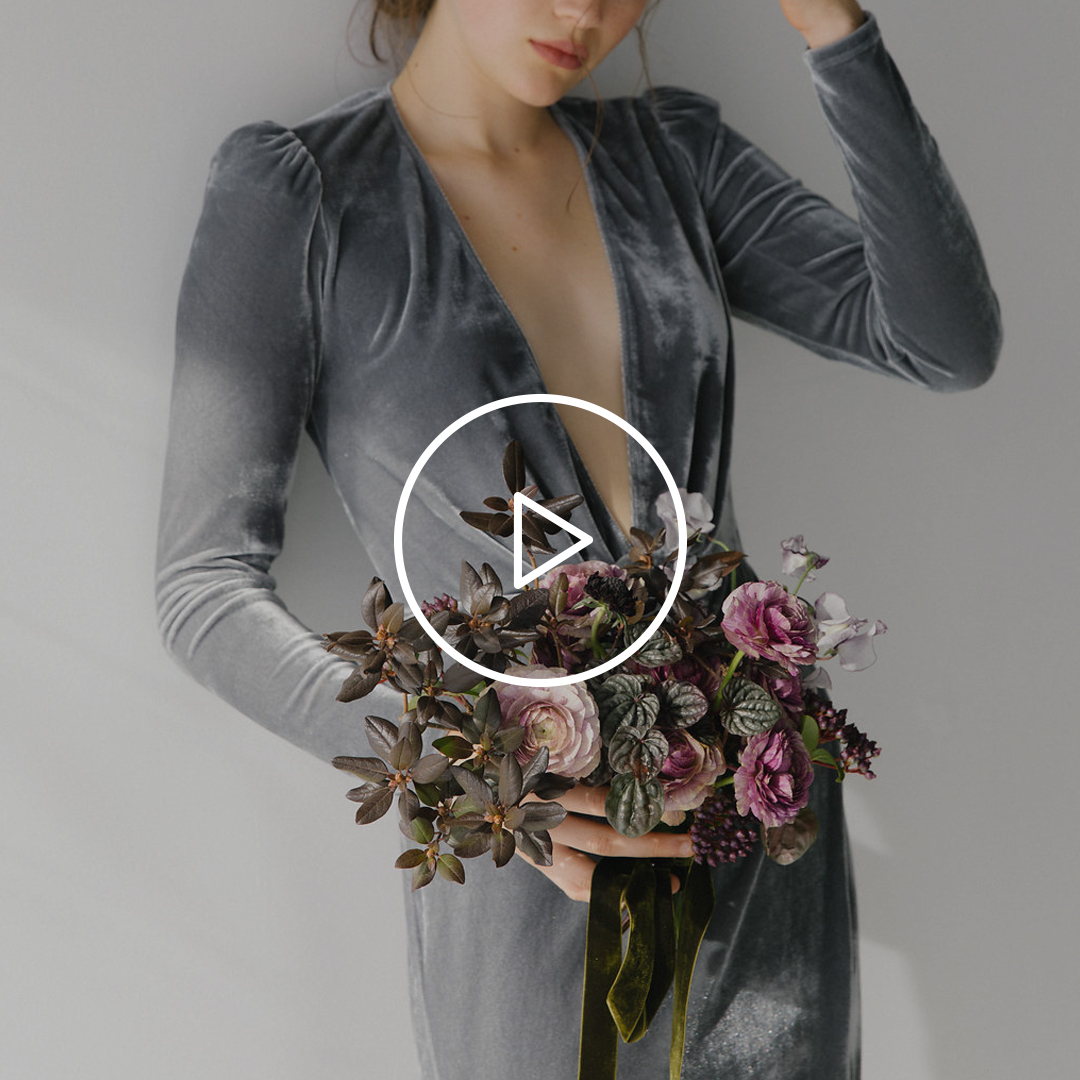 Woman holding hand gathered bouquet