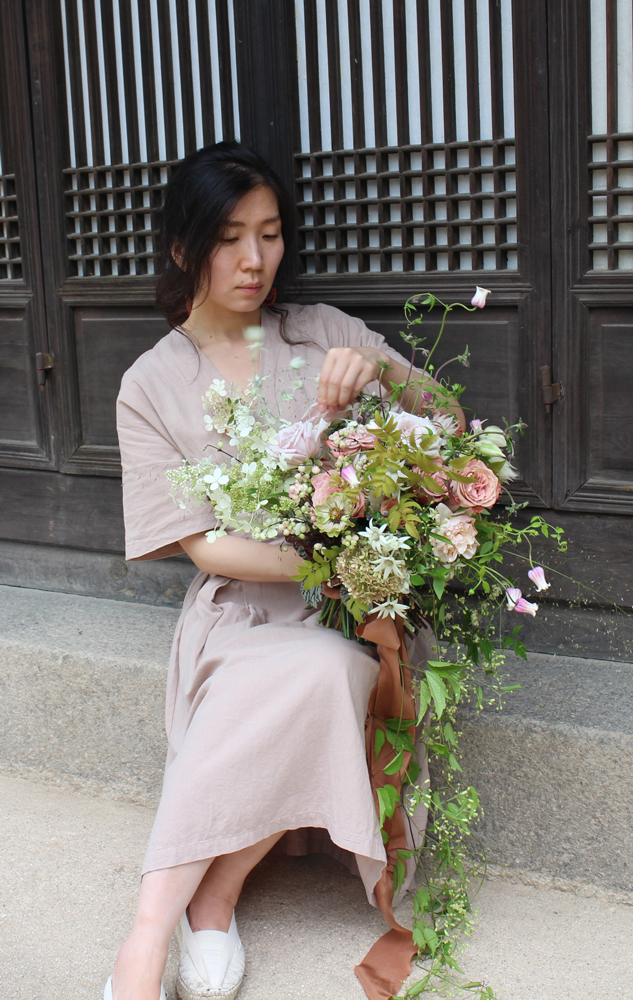 Grace Hwajin Lee holding flowers