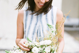 A close up portrait of a bride holding her bouquet