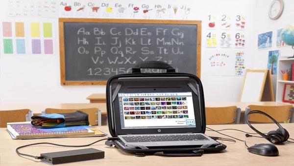 An open HP laptop in a classroom
