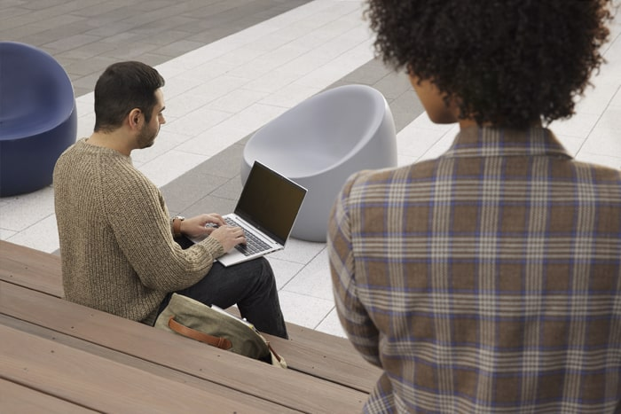 woman looking at someone's laptop screen