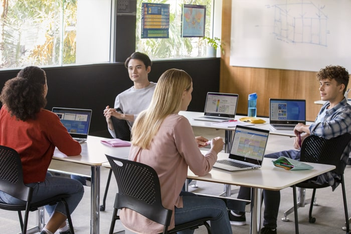 a group of students with laptops