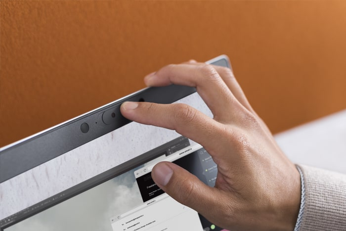 person covering a built in webcam