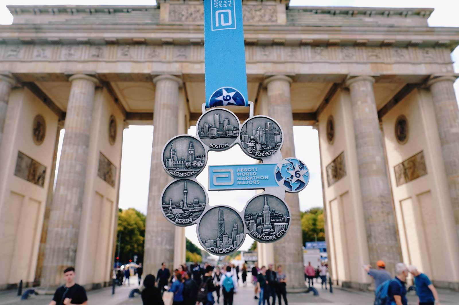 Six Star Finisher medal in front of the Brandenburg Gate Berlin