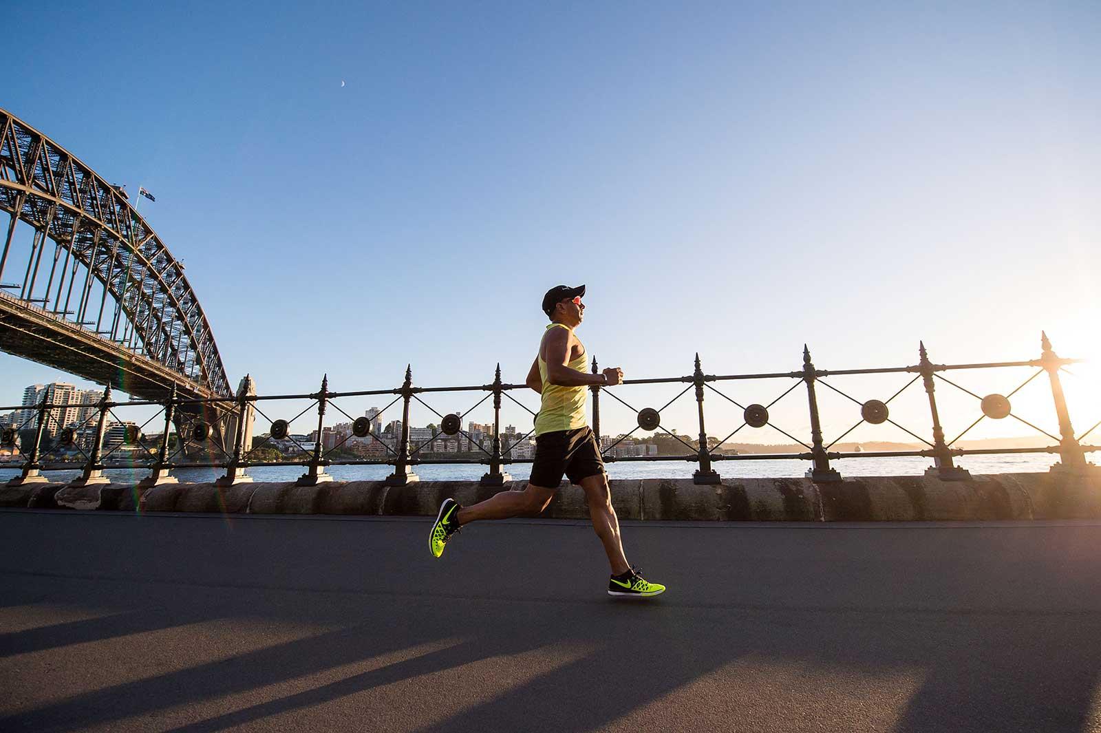 Man jogging near Sydney harbar bridge