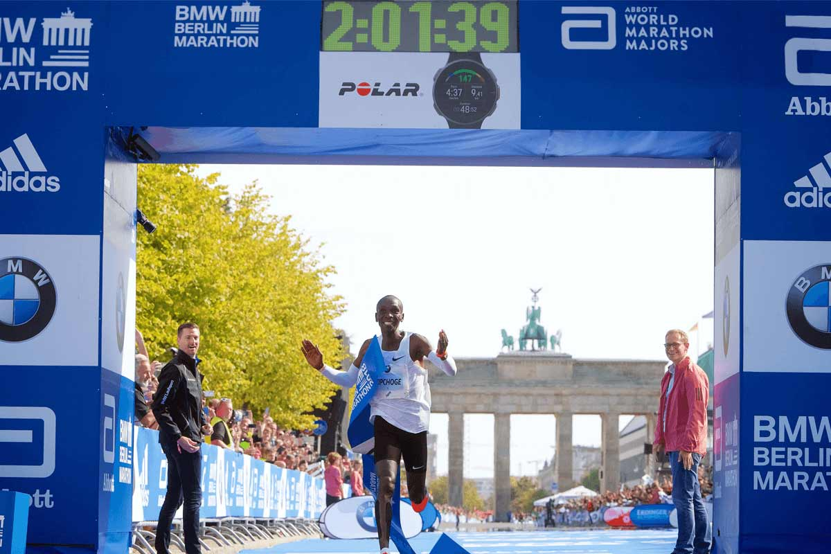 Eliud Kipchoge crosses finish line Berlin