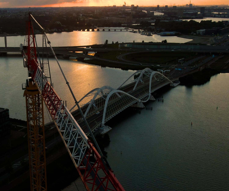 Birds eye view of Amsterdam, water crane and bridge depicted