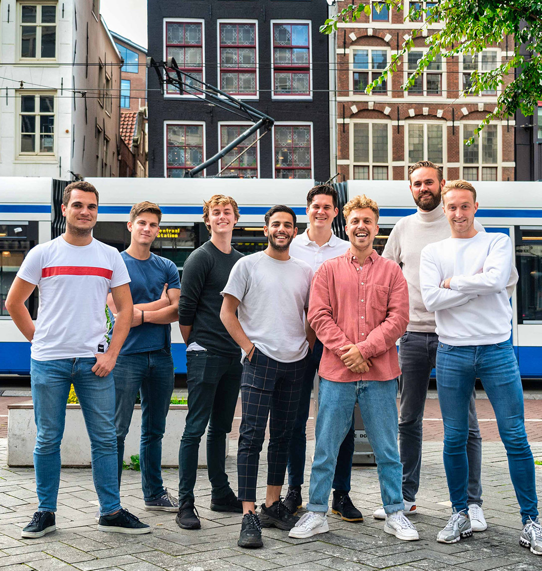 DIQQ team standing in front of a tram in Amsterdam