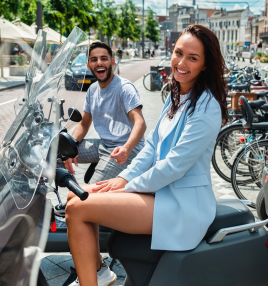 DIQQ employees on scooters in Amsterdam