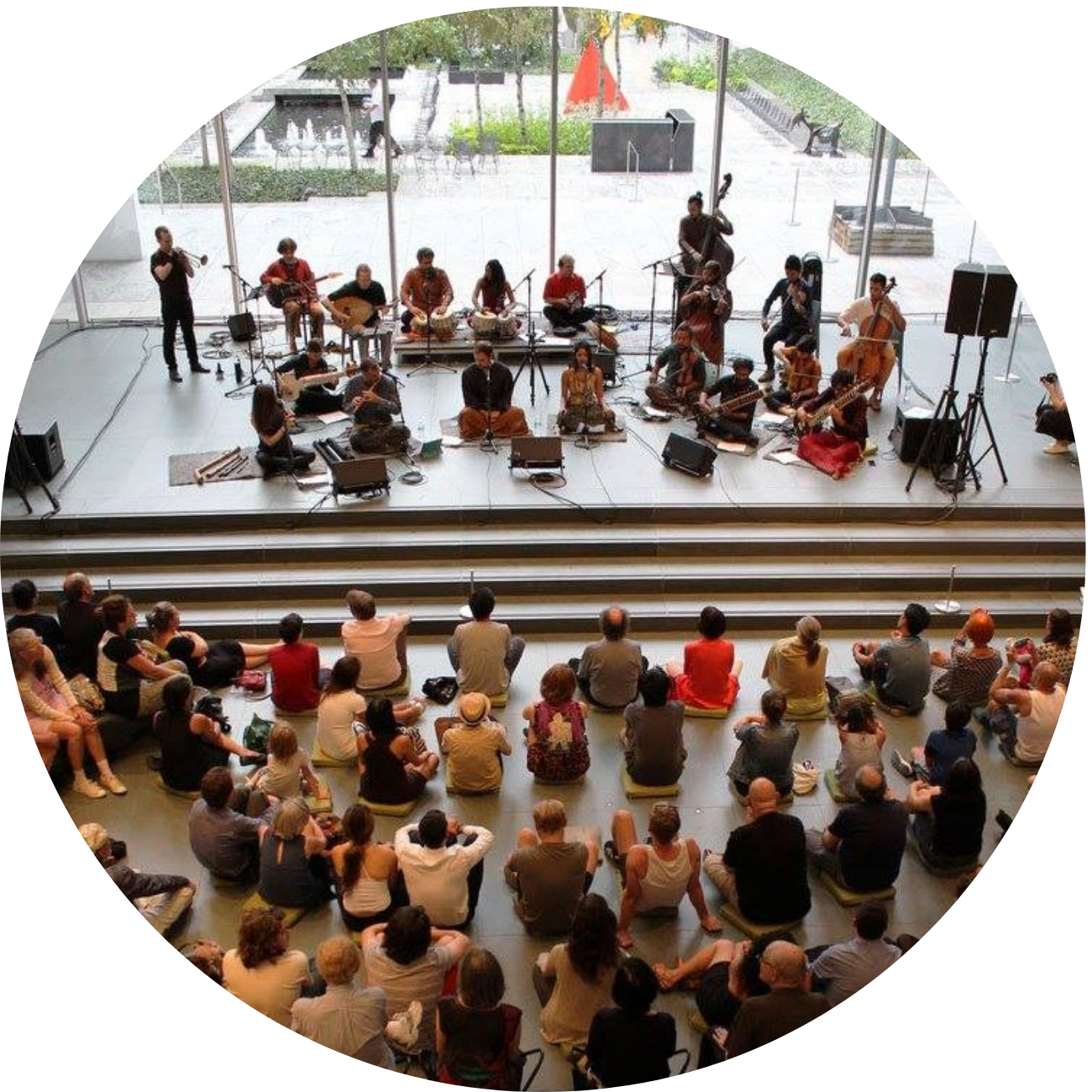 Group of 19 Musicians on a Stage at MoMA performing to a crowd of people sitting on the floor