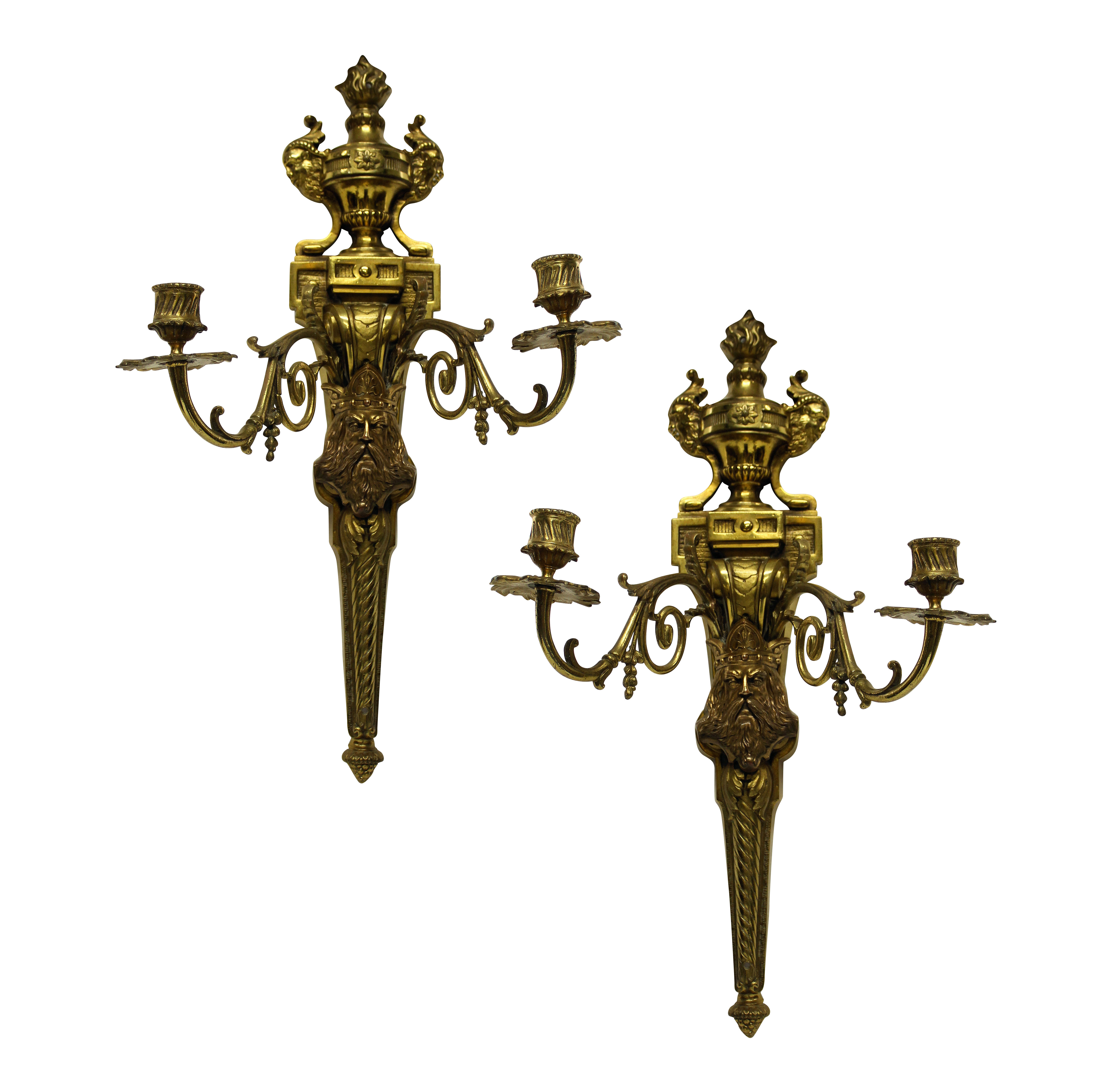 A PAIR OF GILT BRONZE WALL SCONCES DEPICTING KINGS