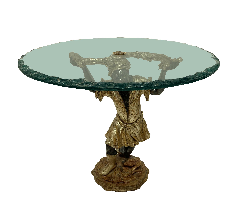 A VENETIAN BLACKAMOOR SIDE TABLE WITH GLASS TOP