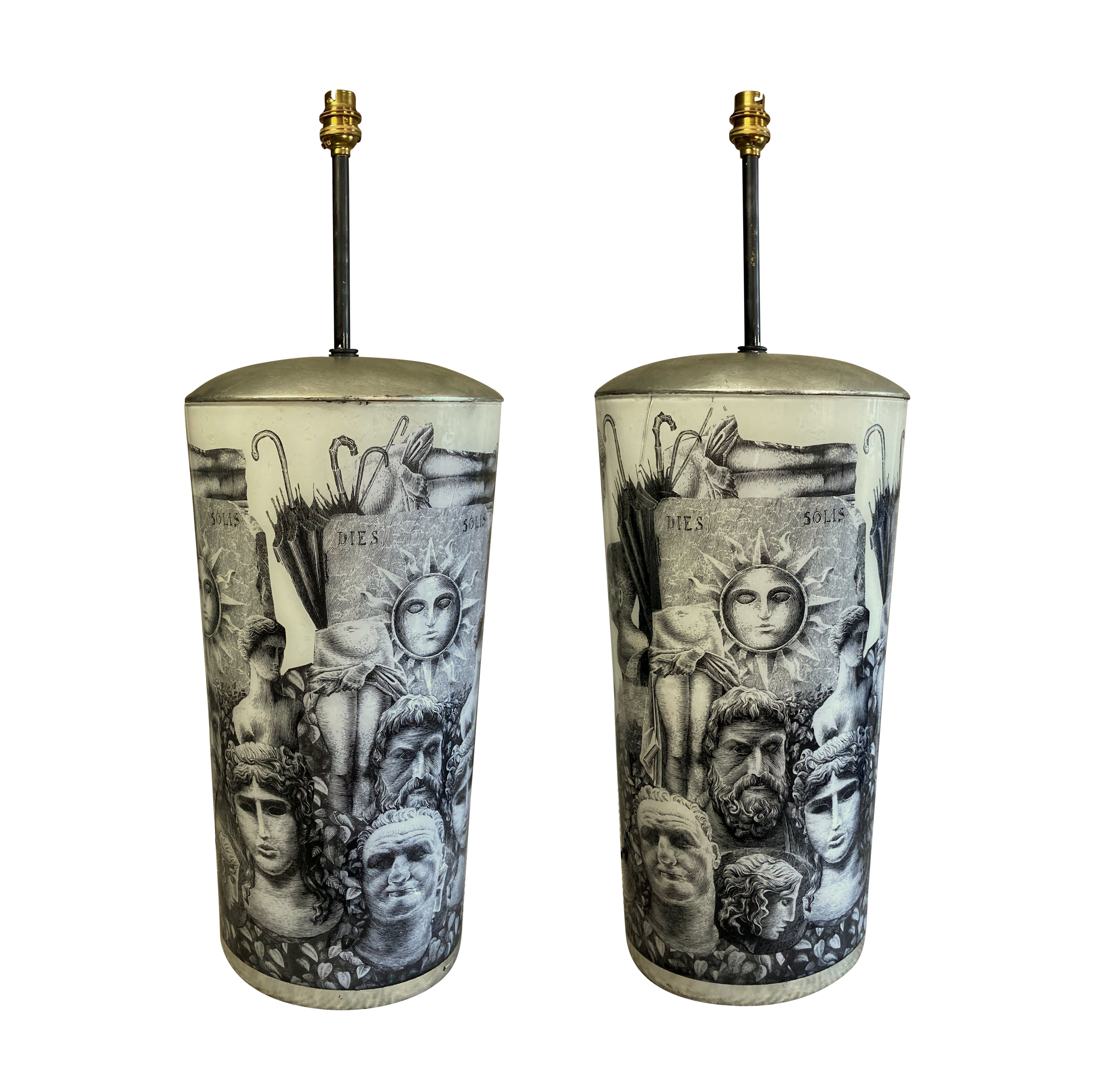 A PAIR OF LARGE EGLOMISE LAMPS IN THE MANNER OF FORNASETTI