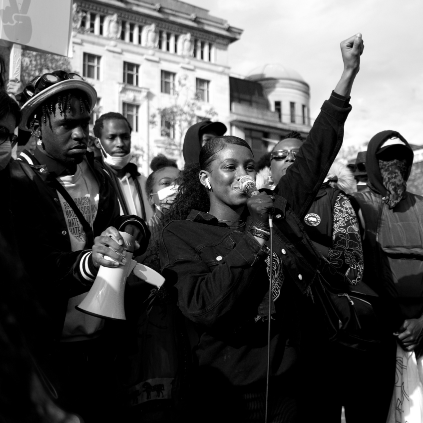 A woman speaking to a crowd