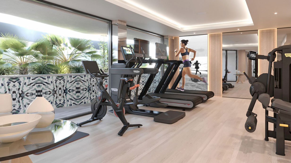 Hotel cardio area with woman running on treadmill