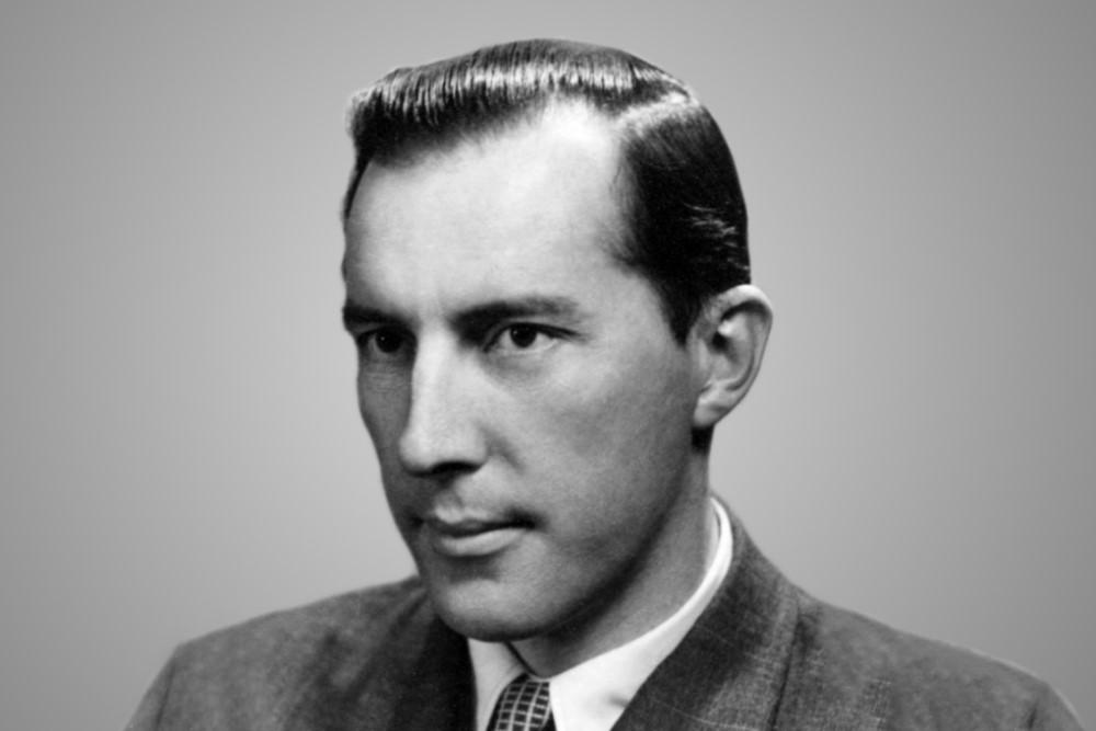 A black and white portrait of Derek Prince in his twenties