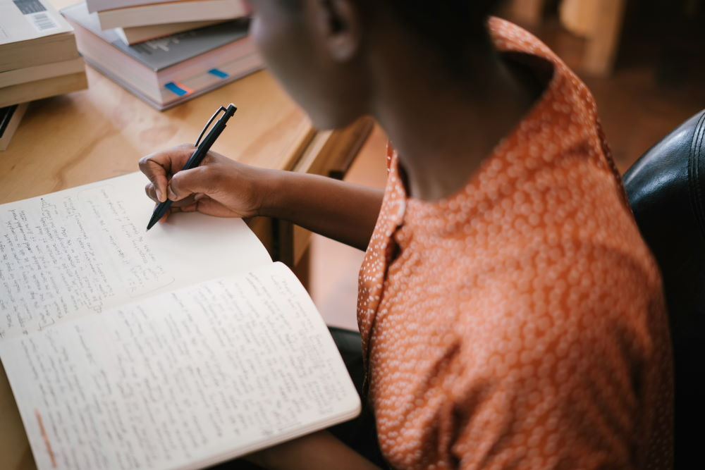 A woman studying the Bible and writing notes