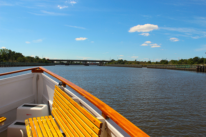 A photo of a one of Classic Harbor Line's boats approaching Staten Island's Freshkills Park.