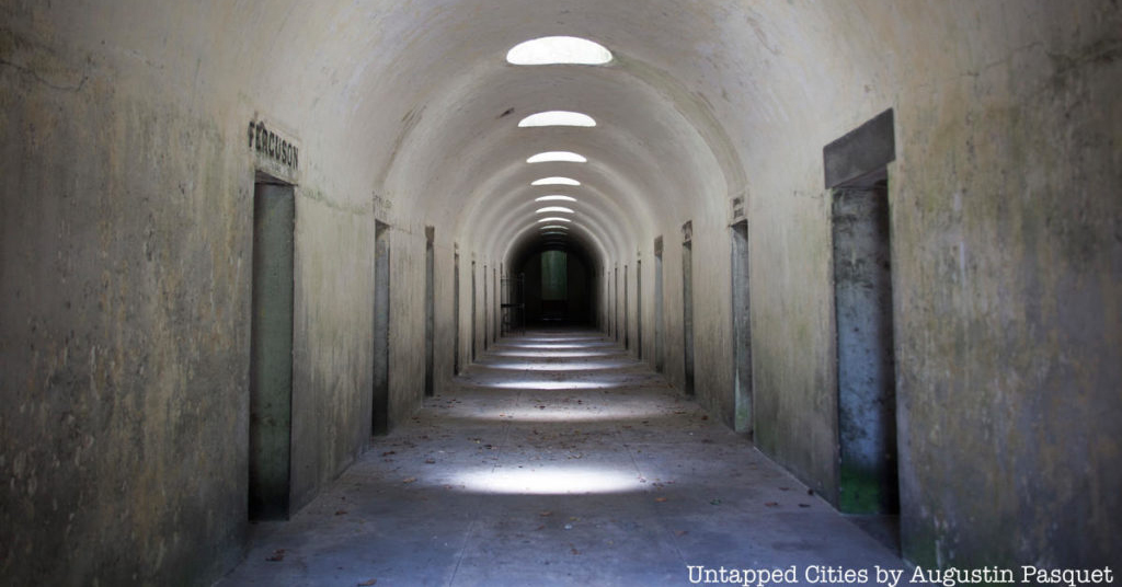 Black and white image of catacomb hallway.