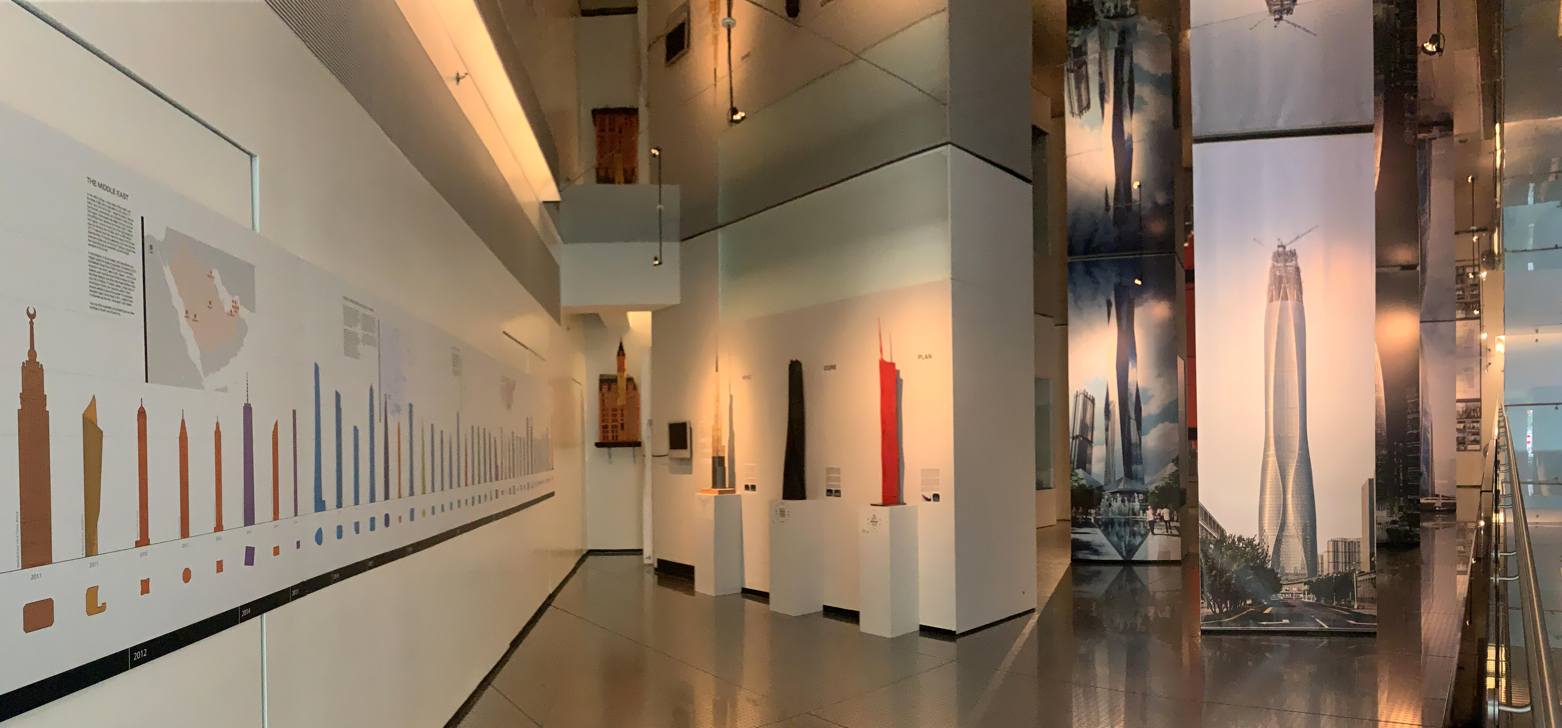Exhibition installation including a graphic outlining the different heights of the tallest skyscrapers.