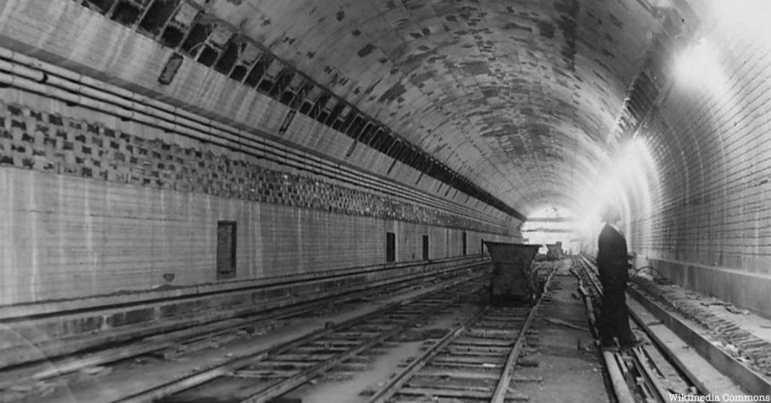 A black and white photograph of the Lincoln Tunnel.
