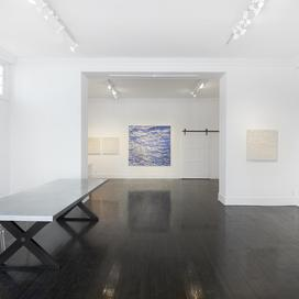 Full-color photo of the interior of a gallery space in New Canaan.