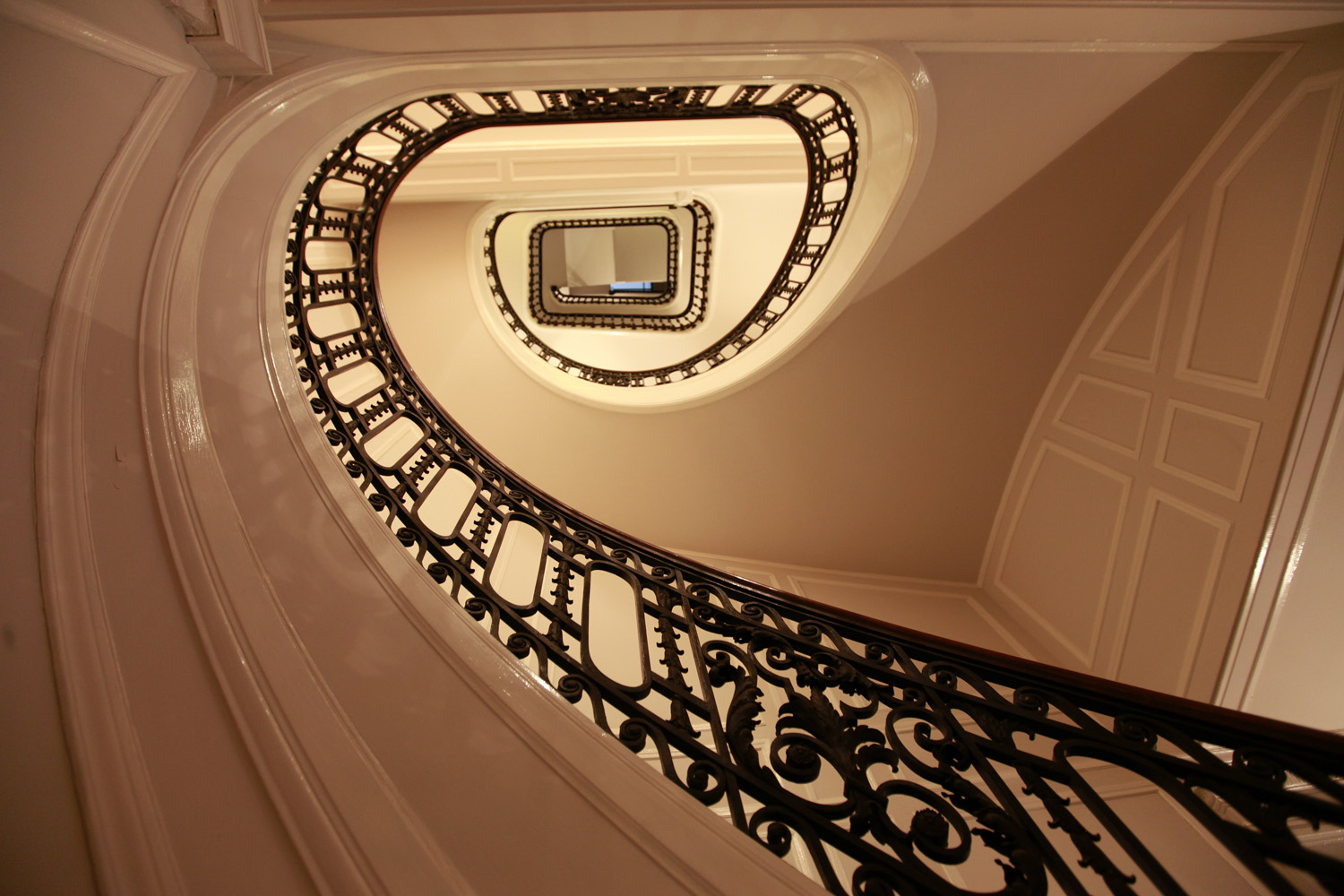 Image of the spiral staircase in 1014 Space taken from the bottom level looking up.
