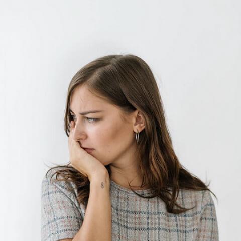Side profile headshot of a woman.
