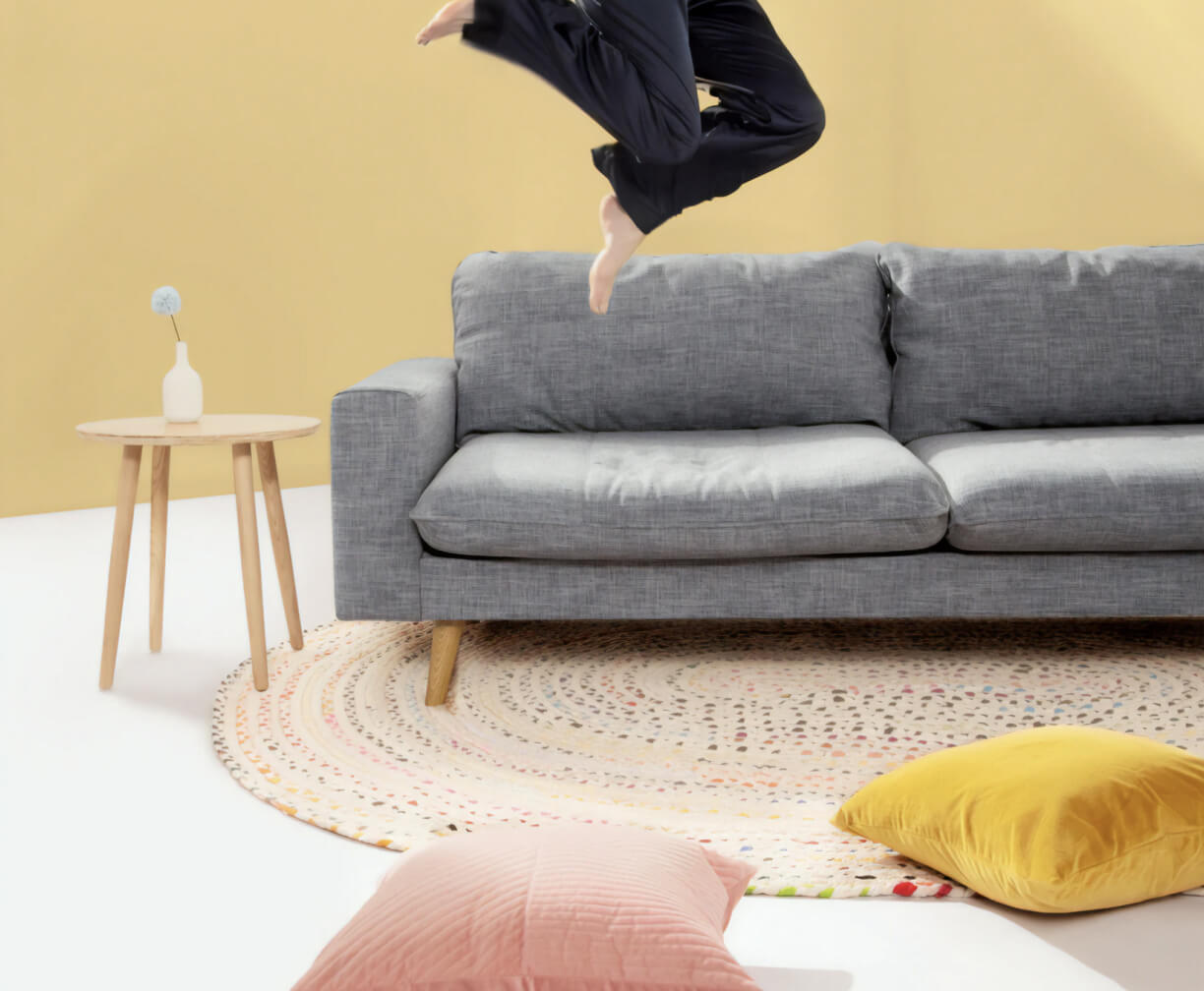 Person jumping off their living room floor.