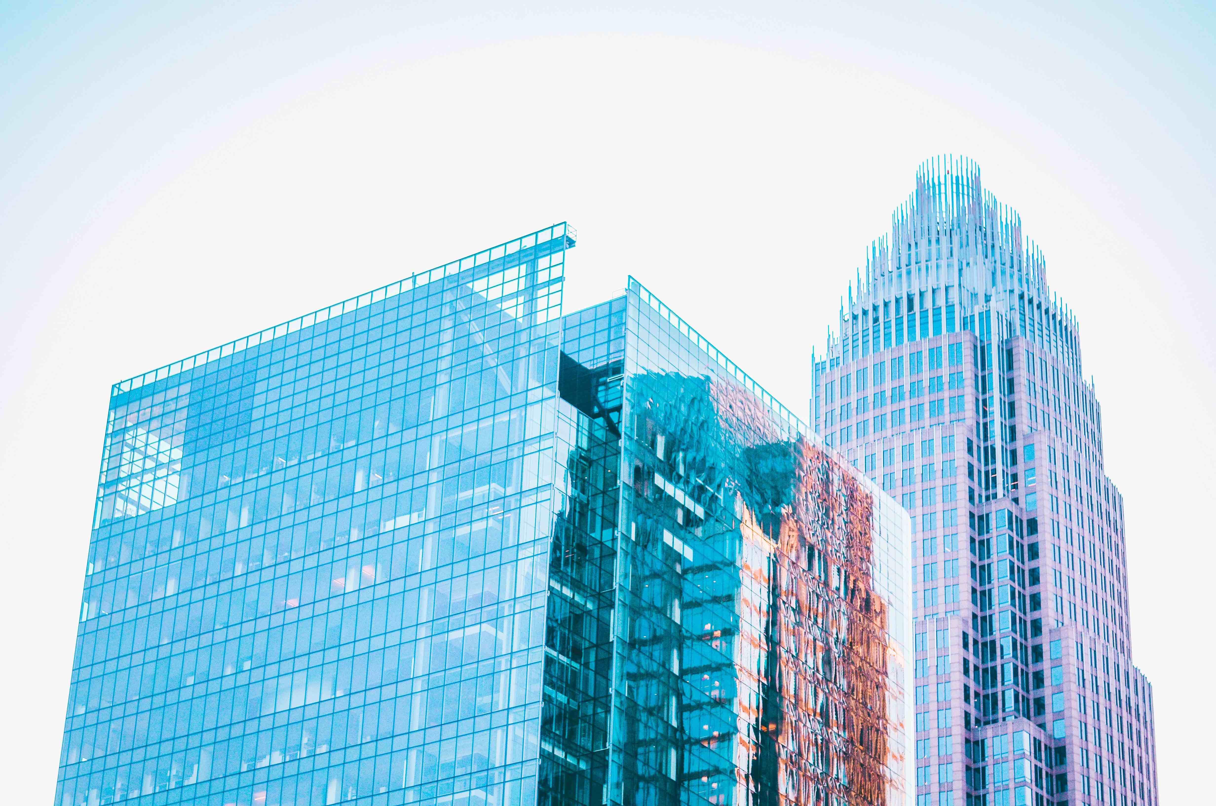 Buildings against a bright blue sky.