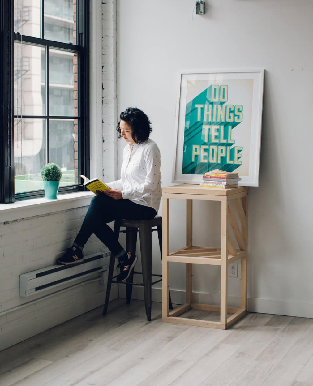 A person posing in their studio.