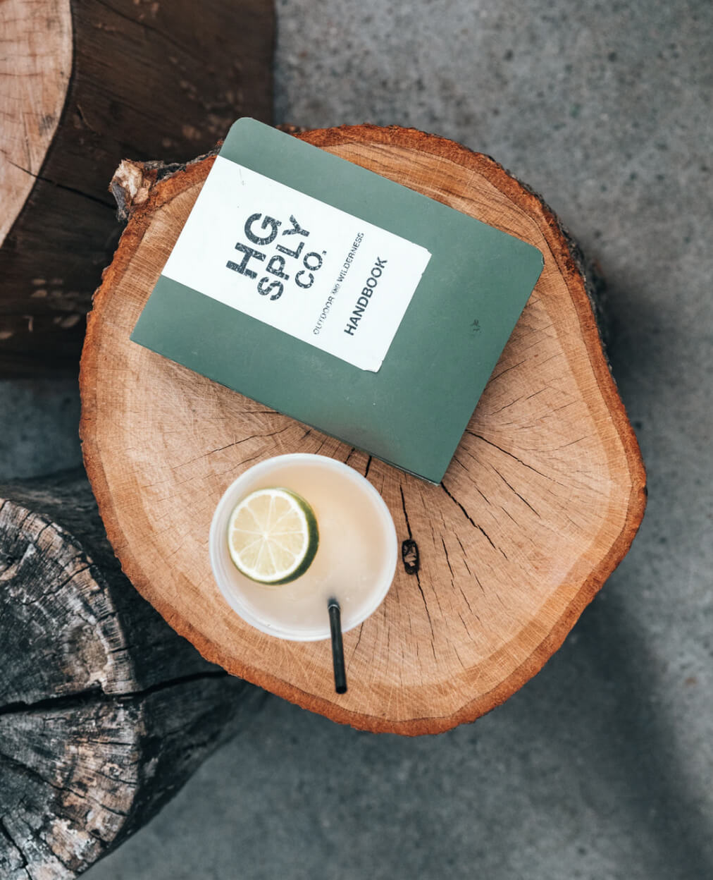 Birds eye view of a book and coffee on a side table.