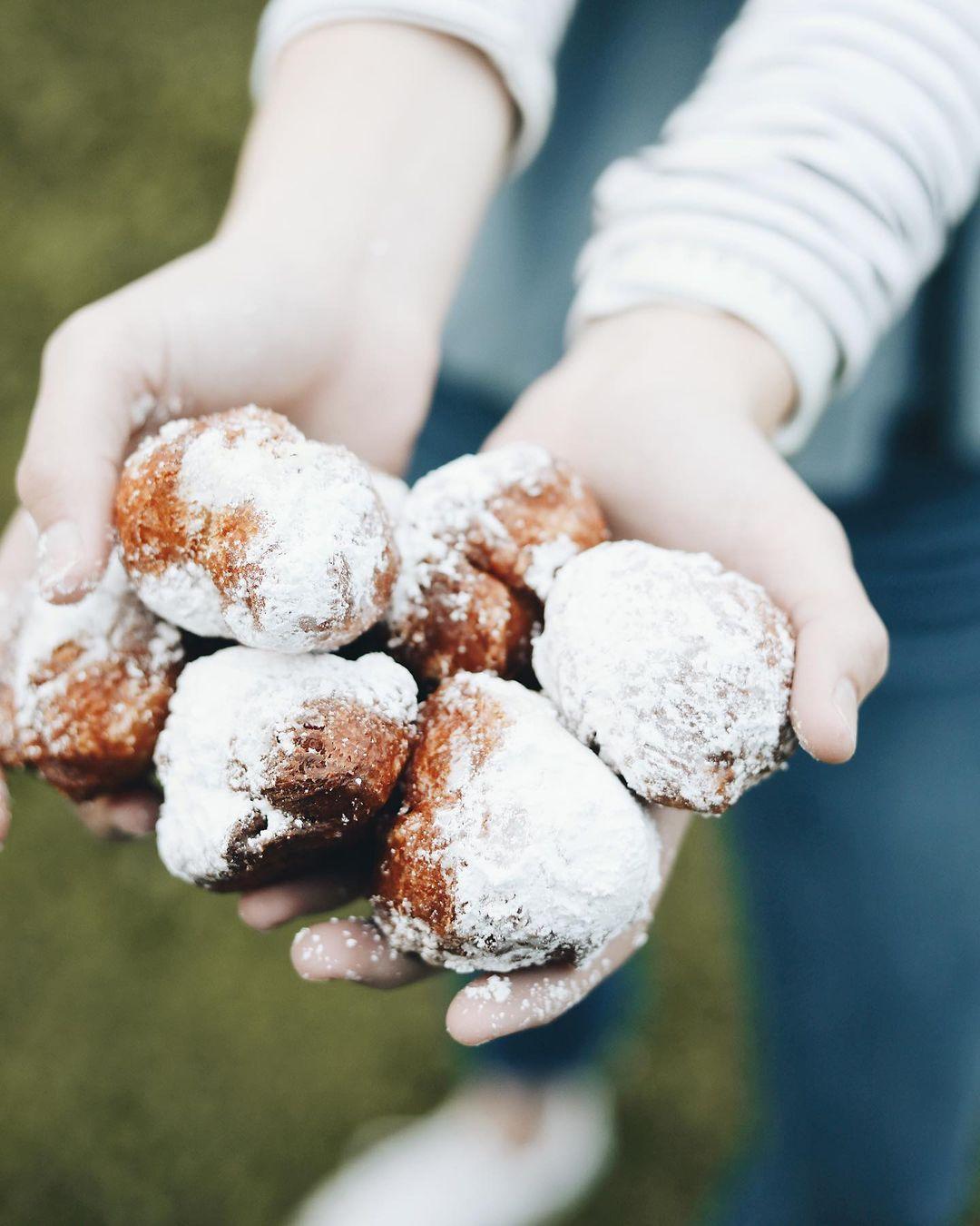Hands Full of Donut Holes