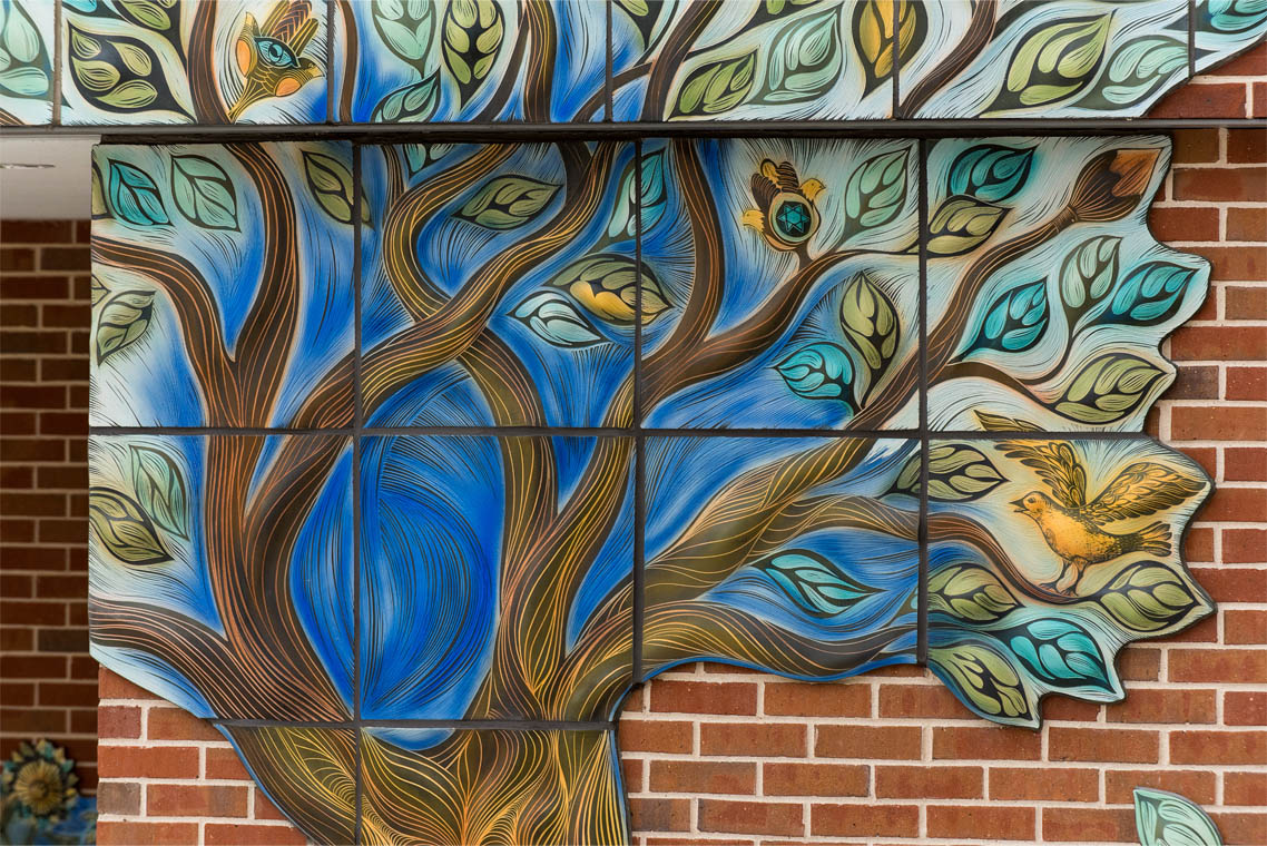 Tree of life tile artwork on exterior of JFS Houston building