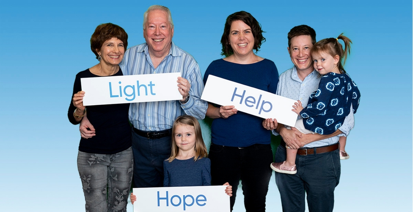"""Diverse Family holding """"light"""" """"Hope"""" signs"""