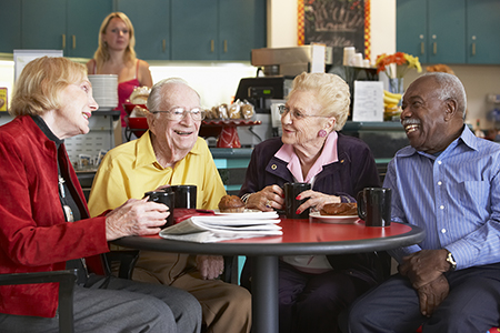 seniors chatting at coffee shop