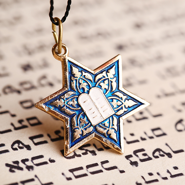 star of david pendant on top of prayer book