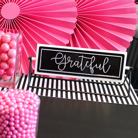 pink candy with black and white grateful sign