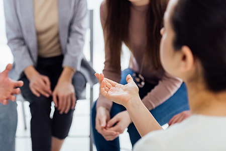 group of four adults in group therapy