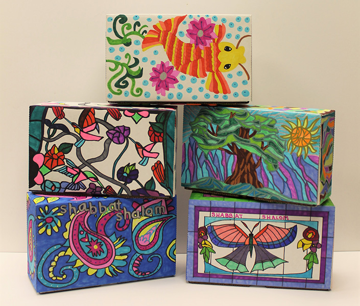 beautifully decorated stacked shabbat boxes