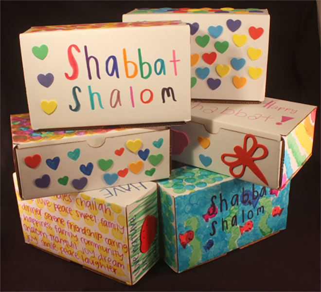 six stacked decorated shabbat boxes