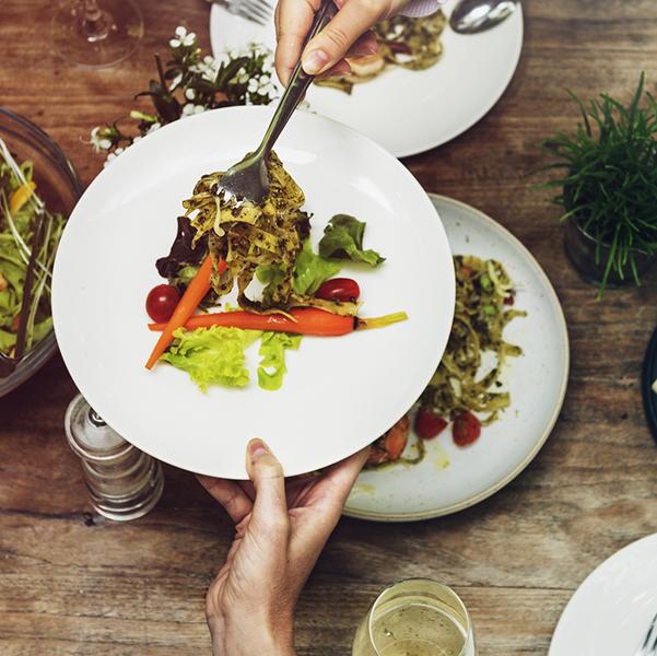 fancy food on dinner plate at restaurant