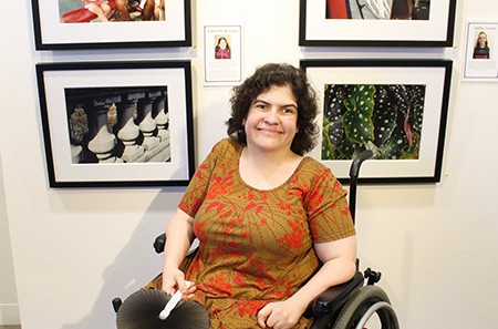 Celebration Company employee with her photographs and art